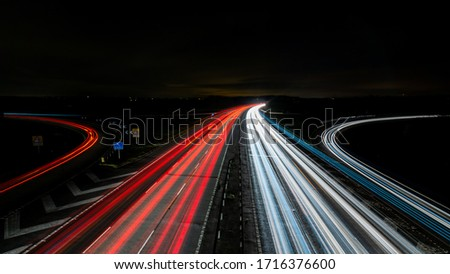 Long exposure of motorway at night with curved off ramps