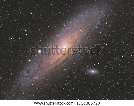 Andromeda galaxy also known as Messier 31 in Andromeda constellation, with many stars as background in the deep space. #1716385720