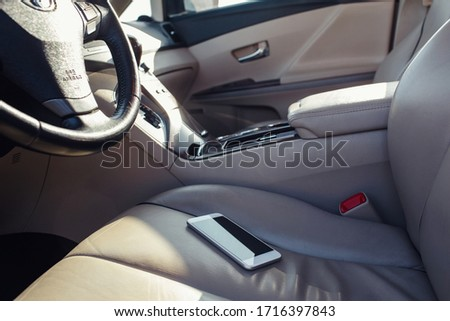 smart phone phone on the car seat dashboard. Lifestyles photo in car. Different views. Without hand, phone. #1716397843