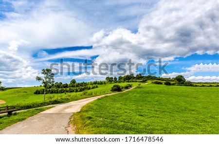 Green hill path sky clouds. Rad to green hill. Green hill road landscape #1716478546