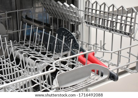 Open dishwasher with dishes inside #1716492088