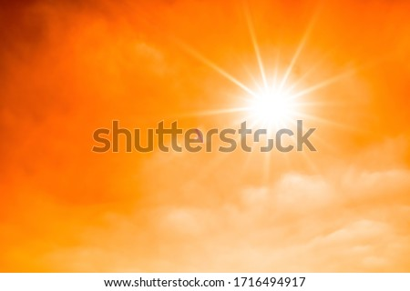 Concept for climate change or global warming, orange sky with with clouds and bright sun #1716494917