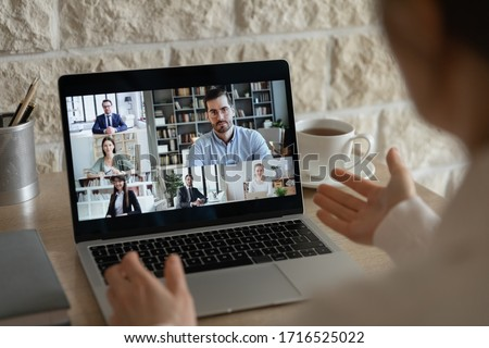 Back view of employee have webcam online conference or conversation with diverse colleagues coworkers, businesspeople talk on video call on laptop, brainstorm discuss business ideas on internet #1716525022