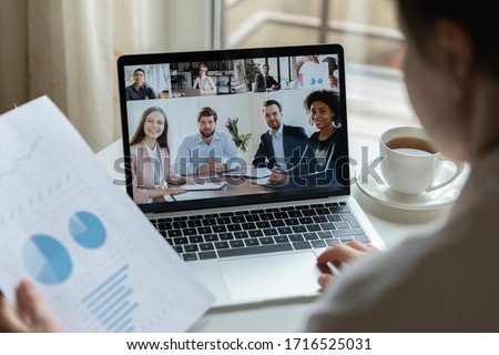 Multiracial businesspeople talk speak on video call discuss financial paperwork statistics online, diverse colleagues have distant webcam conference on laptop, engaged in briefing on web together Royalty-Free Stock Photo #1716525031