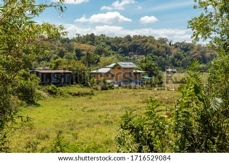 Saradan, Sabah, Malaysia - 25 February 2020: Residential house in the middle of rice fields in Kg. Saradan #1716529084