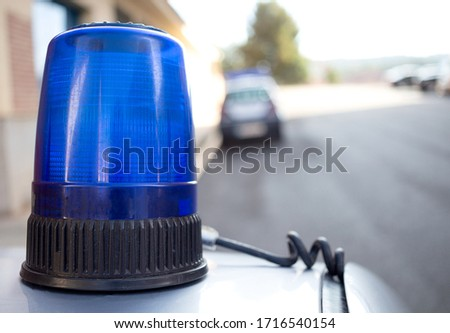 No fake closeup photography of blue portable emergency priority signaling light for police vehicle placed on the roof of a car. Siren flasher.