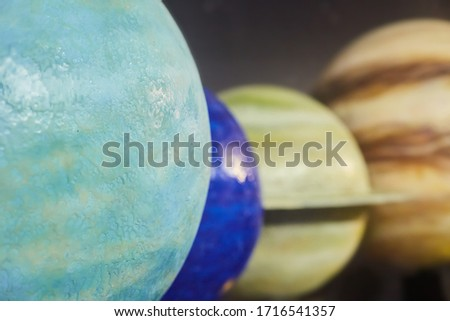 Layout of astronomical objects-planets of the solar system. Balls for studying astronomy. Saturn, Jupiter, Earth, and Uranus.