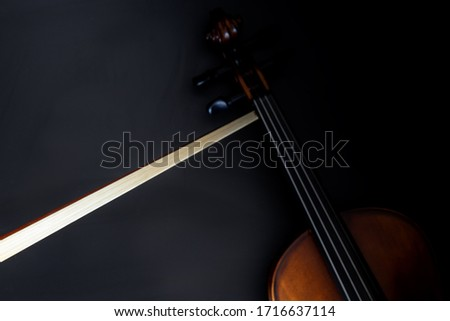violin bow with violin on black background top view, dark theme #1716637114