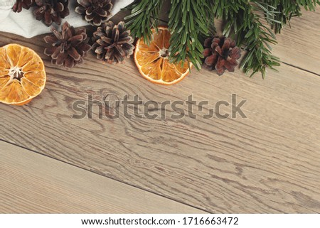 Zero waste and eco friendly christmas concept. Natural decorations and branches of Christmas tree on the wooden table, top view, flat lay, copy space