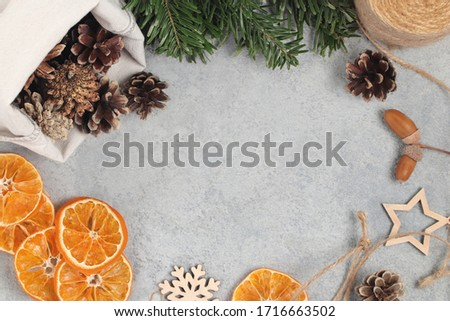 Zero waste and eco friendly christmas concept. Natural decorations and branches of a Christmas tree on the table, top view, flatlay