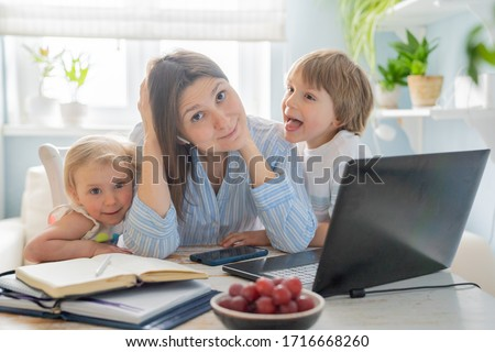 Female working from home with kids running and screaming, kitchen background #1716668260