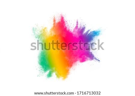 Freeze motion of colorful color powder exploding on white background.  Paint Holi.Indian festival Holi #1716713032