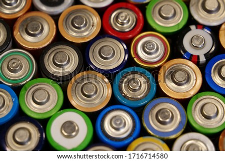 A lot of multicolored used batteries #1716714580