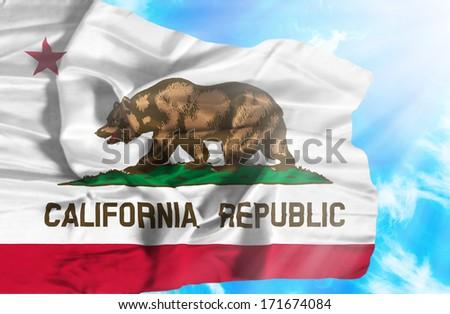 California waving flag against blue sky with sunrays #171674084