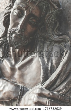 Vintage photo style. Fragment of Jesus Christ statue as a symbol of love, faith and religion.