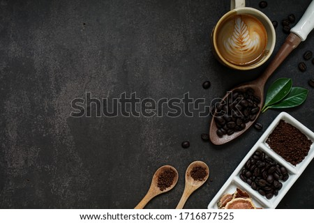 Coffee composition and beans on old kitchen table. Top view with copyspace for your text.