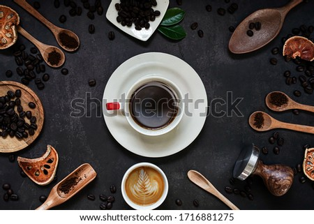 Cup of espresso with Coffee composition on old kitchen table.copyspace for your text.