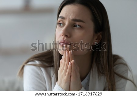 Upset thoughtful young woman look in window distance thinking or pondering, unhappy millennial girl lost in thoughts, feel lonely or distressed, suffer from breakup or relationships problems Royalty-Free Stock Photo #1716917629