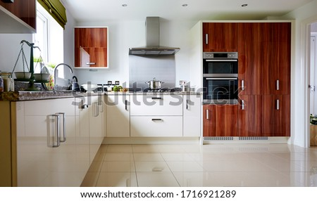 Modern interior of a large kitchen with modular furniture in white color #1716921289