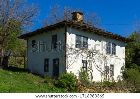 STARO STEFANOVO, BULGARIA - APRIL 9, 2014: Old houses at historical village of Staro Stefanovo, Lovech region, Bulgaria #1716983365
