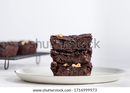 Front view of homemade chocolate brownie with white backdrop. #1716999973