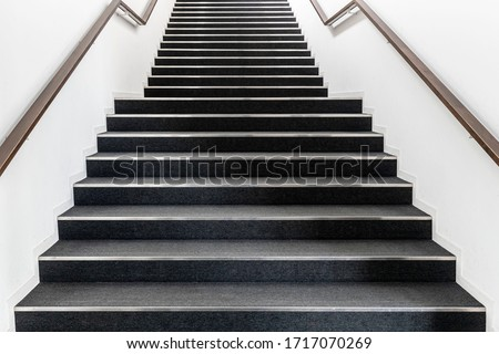 Long stair concrete in office building Royalty-Free Stock Photo #1717070269