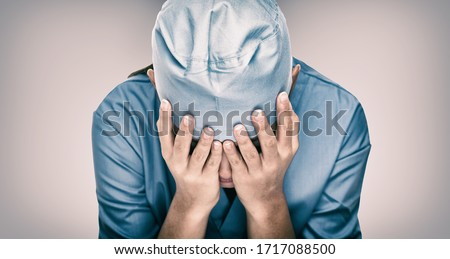 Crying doctor during COVID-19 needing help in hospital. Healthcare workers in despair over emergency need of PPE and distress. Coronavirus crisis death, dispair, mental health anxiety. #1717088500