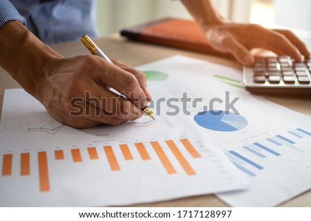 Business men looking at charts, spreadsheets, graph financial development, bank accounts, statistics, economy, data analysis, investment analysis, stock exchange Royalty-Free Stock Photo #1717128997