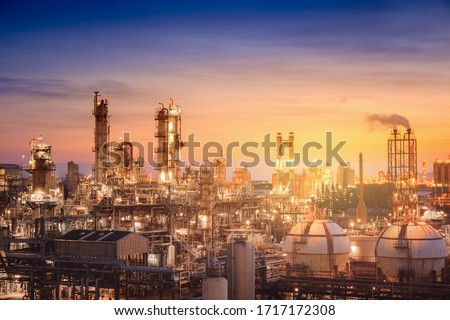 Oil and gas refinery plant or petrochemical industry on sky sunset background, Factory with evening, Manufacturing of petrochemical industrial #1717172308