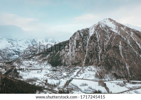 The village Palleusieux under a big mountain, in the Basin Pre-Saint-Didier, Aosta Valley at the time of corona virus outbreak, northern Italy #1717245415