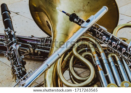 Mixed wind quintet instruments, black and white, gold, silver and wood. Royalty-Free Stock Photo #1717263565