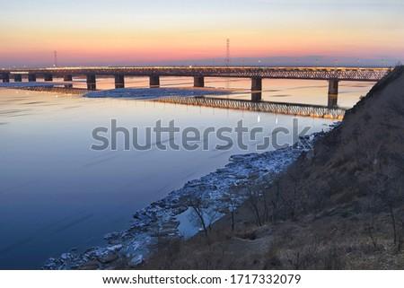 Ice floating on the Amur river. Motion blur. Amur bridge area. Trans siberian railway. Khabarovsk, far East, Russia. #1717332079