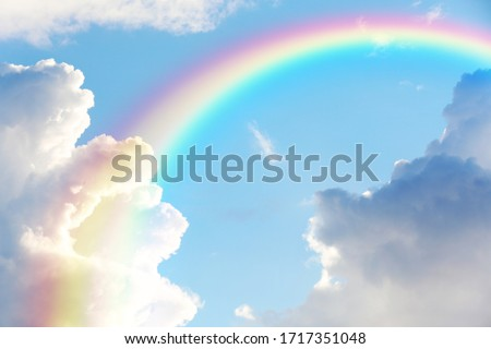 Picturesque view of beautiful rainbow and blue sky on sunny day  Royalty-Free Stock Photo #1717351048