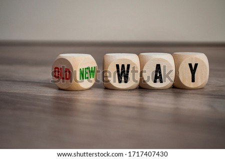 Cubes and dice with message old way and new way on wooden background Royalty-Free Stock Photo #1717407430