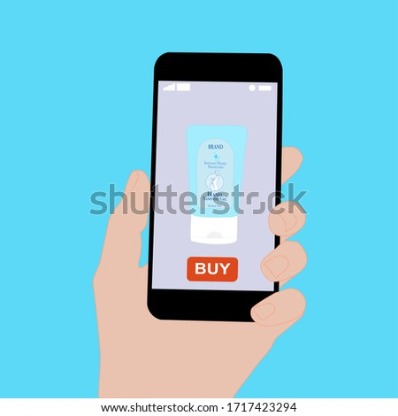 Hand holding smart phone with buy button on the screen. Contactless online purchase of goods using your phone. Use Hand sanitizer tube. Diseases prevention (coronavirus). Home delivery. #1717423294