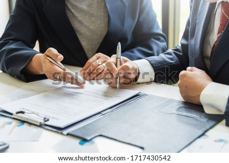 Businessman sign the contract, the agreement in the document. #1717430542