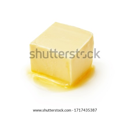 A piece of melting butter isolated on white background. Butter cube. #1717435387
