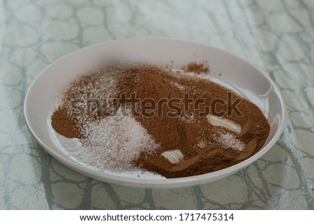 saucer with mixed brown cinnamon and white sugar. dessert roll stuffing #1717475314