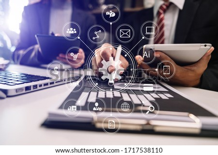 Working team meeting concept, business using laptop and smart phone and digital tablet computer with digital marketing media  in virtual icon network diagram office in morning light  #1717538110