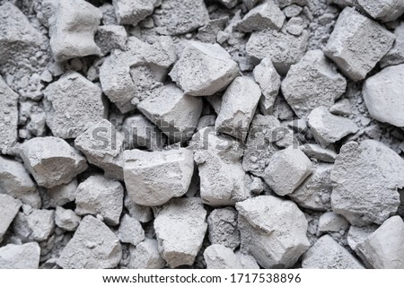 Debris of broken concrete cement rubble with a large and small debris. Close up photo. Picture can be used as a pattern or background. #1717538896