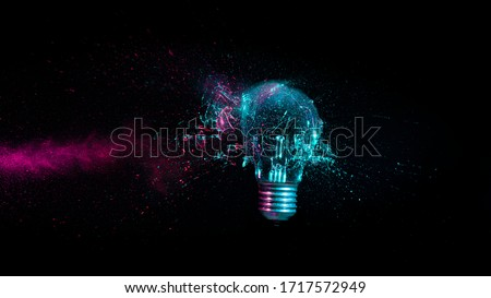explosion of a traditional electric bulb. shot taken in high speed, at the exact moment of impact. concept of creativity and fragility. #1717572949