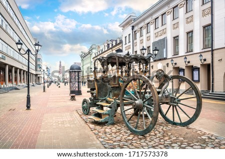 A carriage on Bauman Street in Kazan among ancient buildings and lanterns on a sunny spring day Royalty-Free Stock Photo #1717573378