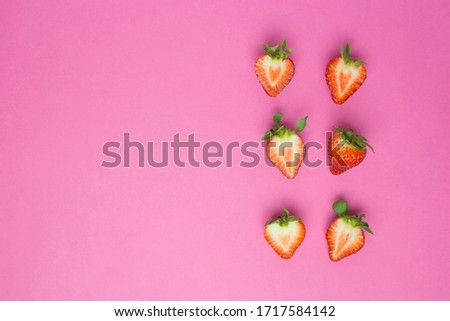 Strawberries isolated on pink background. Fresh berry flat lay. Creative food concept. Copy space, whole berries and halves #1717584142