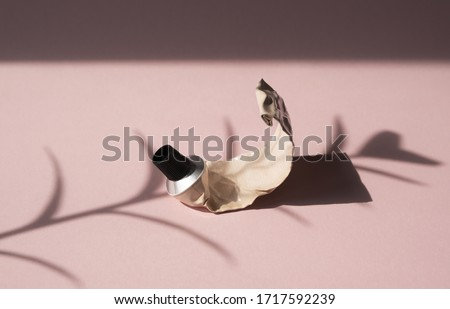 Used tube of cream on the pink background. The concept of ecology, plastic free, aesthetic, minimalism in cosmetic beauty products.  Royalty-Free Stock Photo #1717592239