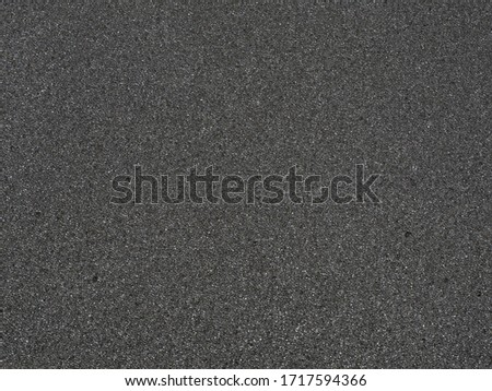 Black micro sponge texture. Soft rubber material background with a high resolution suitable for graphic, top view. #1717594366