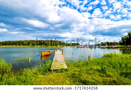 Rural river pier boat landscape. River pier boat view. Boat at river pier #1717614358