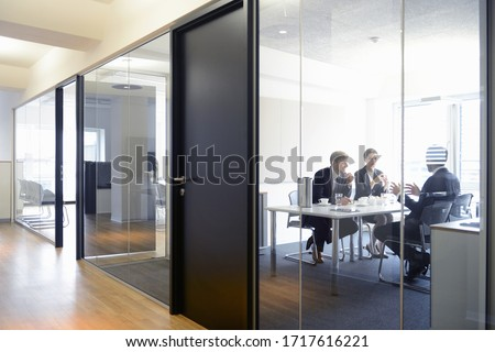 Business colleagues in conference room Royalty-Free Stock Photo #1717616221