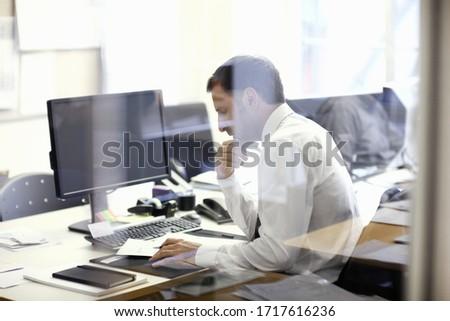 Mature office worker at desk #1717616236
