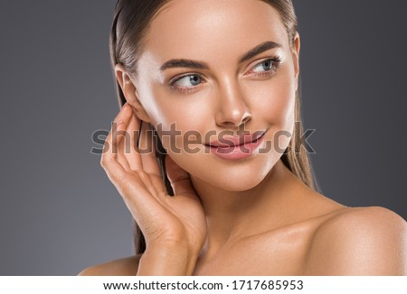 Wonab face close up beauty skin beautiful eyes lips skincare manicure hand touching skin healthy fresh face macro female cosmetic portrait Royalty-Free Stock Photo #1717685953