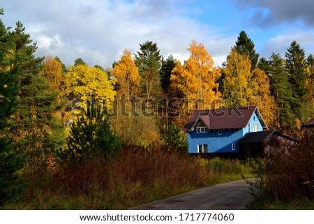 Blue village house in autumn